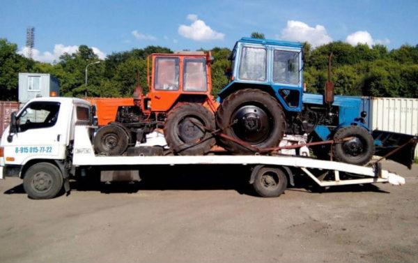Эвакуация два трактора фото