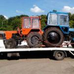 Перевозка двух тракторов фото