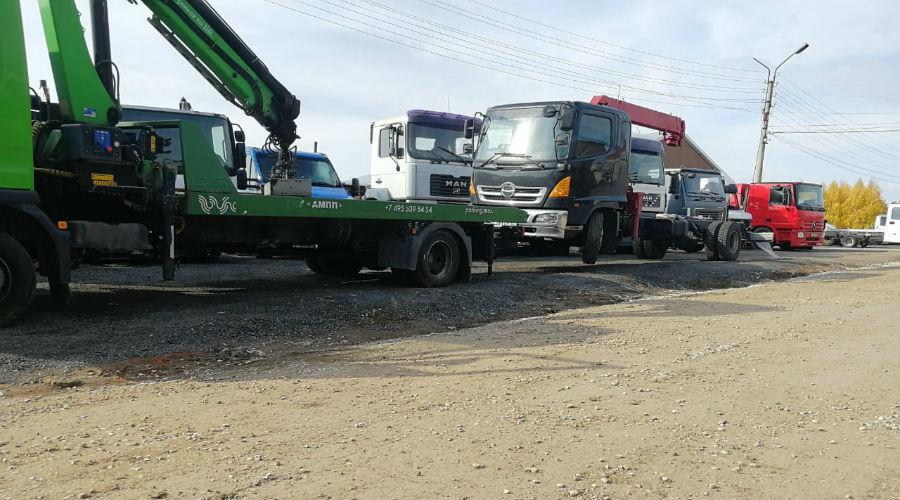 Перевозка грузового авто частичной погручкой