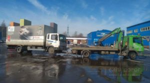 Перевозка большого грузового авто частичной погрузкой